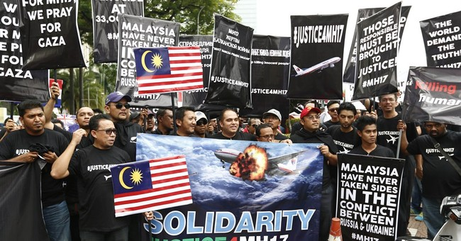 Protesters in Malaysia seek justice from Russia