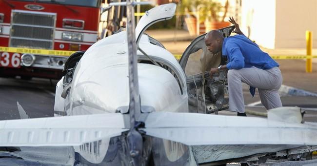 Passenger dies, pilot hurt in parking lot crash
