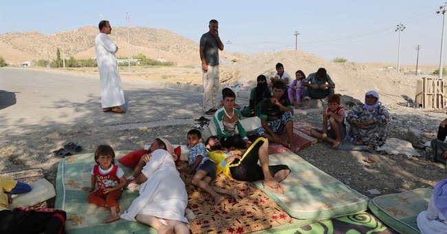 Islamic fighters kill scores of Yazidi men in Iraq