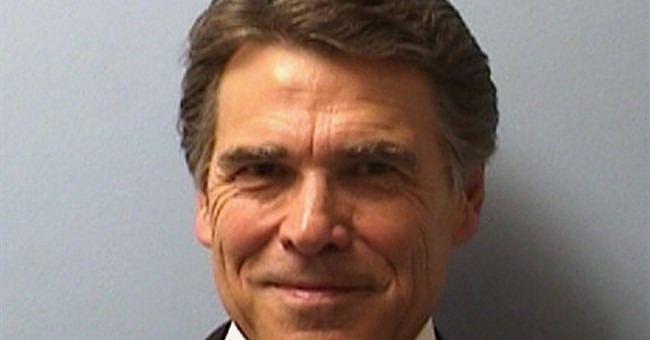 Texas Gov. Perry booked on abuse of power charges