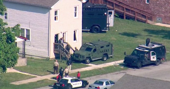 Last 4 hostages freed in suburban Chicago standoff