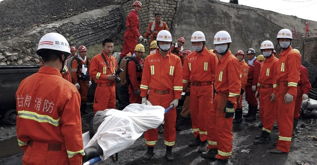 China says it saw a drop in mining deaths in 2013