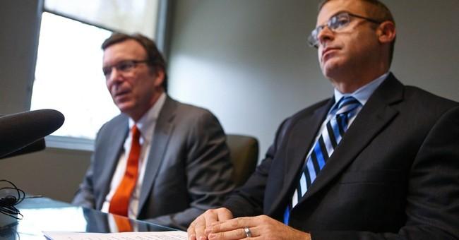 Gay vice principal sues Seattle Archdiocese