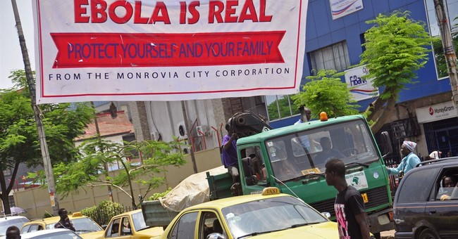 "Will Liberia's ""Iron Lady"" Contain Ebola Outbreak, Get Her Country Back On Track?"