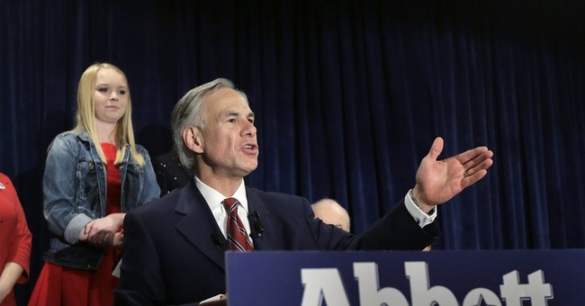 Progress Texas Photoshops Paraplegic Attorney General to be Standing Up in Ad