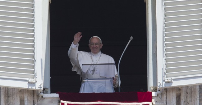 Pope embraces Al-Azhar imam in sign of renewed relations