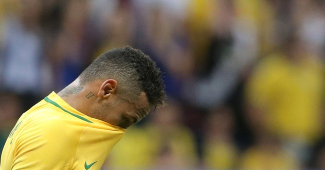 Olympics-Soccer-Stop booing or risk losing top players: Brazil coach