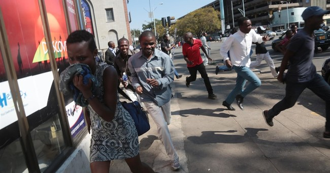 Police teargas anti-Mugabe protesters