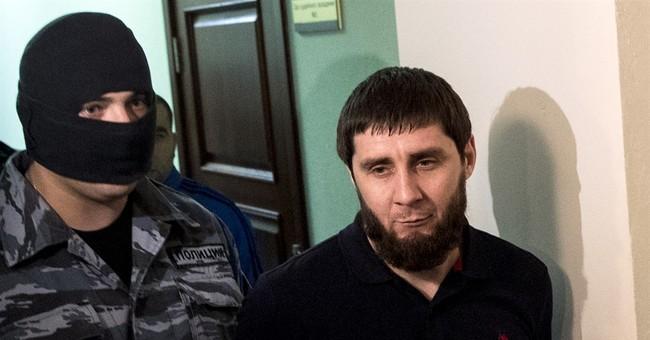 Suspects in Russian politician's killing plead not guilty