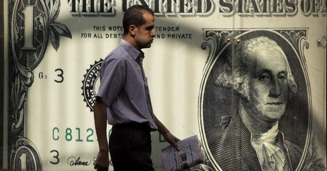 Egypt devalues currency by 48% to meet IMF loan demand