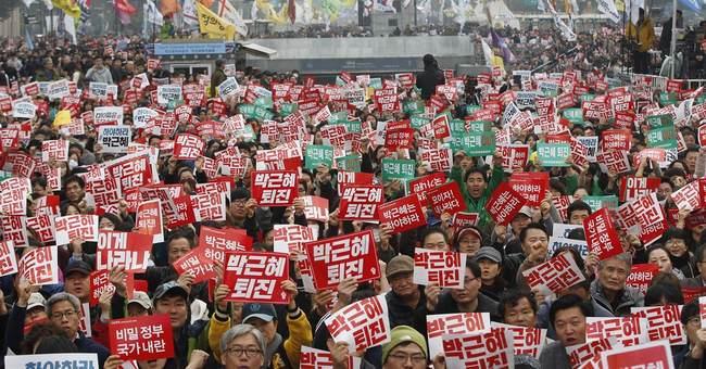 S. Korea prosecutors OK arrest of Park's aides