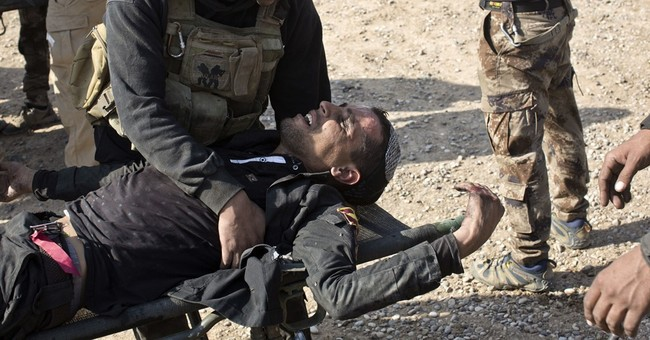 Mass grave with 100 bodies found near Mosul