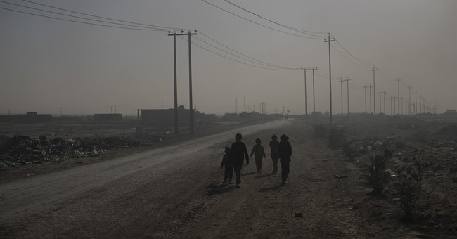 Iraqi PMF cut off highway leading from Mosul to Syria