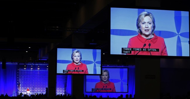 Republican group likens Clinton to Trump in advertisement