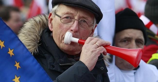 Poles protest conservative govt, defend Lech Walesa