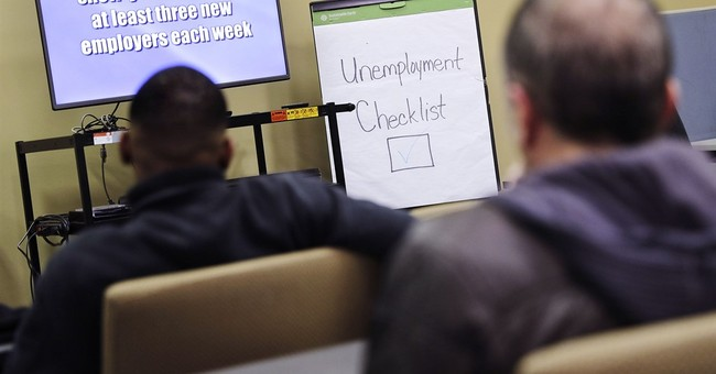 US unemployment claims fall to 12-week low
