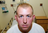 DOJ Report: Michael Brown Fought With Officer Wilson, Reached For His Gun