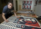 Shepard Fairey says design no longer reflects reality of Obama administration.