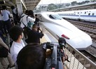 Two passengers on a Japanese Shinkansen bullet train died on Tuesday after one doused himself in oil and set it ablaze
