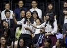 Vietnamese rapper Suboi shows her skills to U.S. President Barack Obama during a town hall with youth in Ho Chi Minh City.