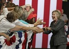 Hillary Clinton proudly claims the woman card in the presidential race during speech Wednesday, June 22, 2016, at the North Carolina State Fairgrounds Exposition Center in Raleigh, NC.