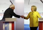 Clinton, Sanders Clash Over Wall Street, Obama