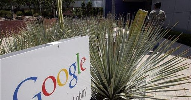 Google reshuffles placement of online search ads