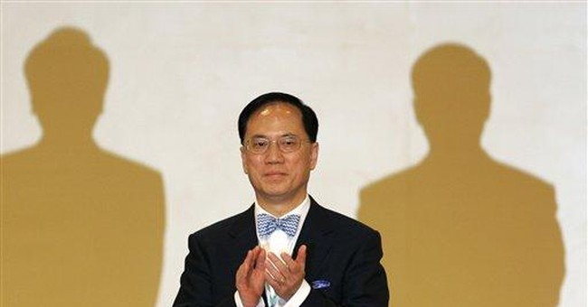 HK's No. 2 official quits, mulls leadership bid