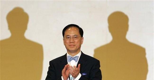 HK's No. 2 official quits, mulls leadership bid