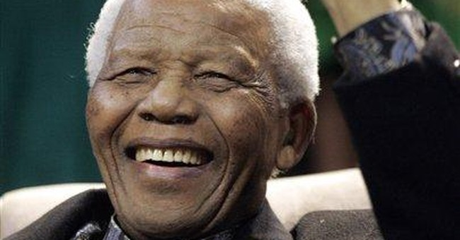 Mandela resting in his South African home village