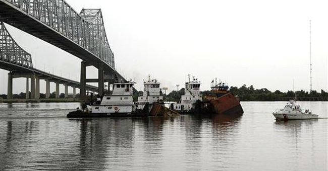 Storm sinks barge in RI; fuel sheen apparent