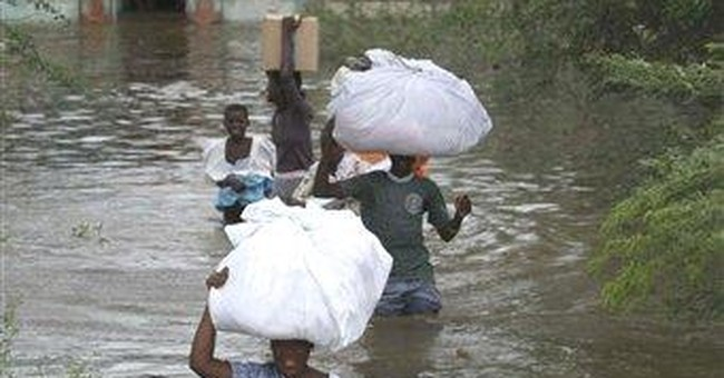 Evacuations in Haiti as lake overflows its banks