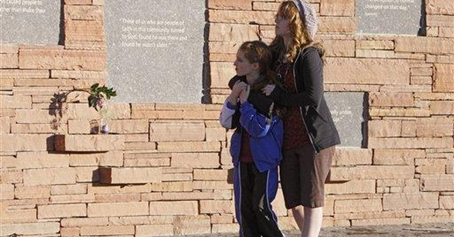 Trial set for man accused in Colo. school shooting