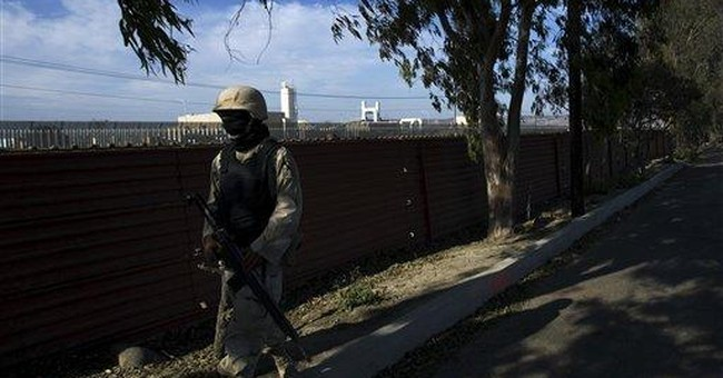 Smugglers hand off drugs through new border fence