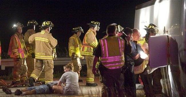 3 dead in pickup, school van crash in Nebraska