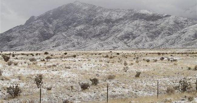 Heavy snow hits NM, closes roads, cancels flights