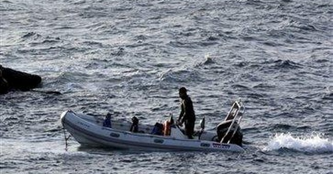 5 men rescued from capsized boat off NC coast
