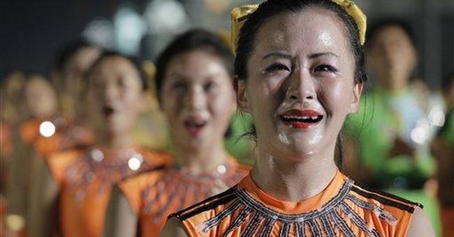 North Korea's Kim and heir appear at lavish parade