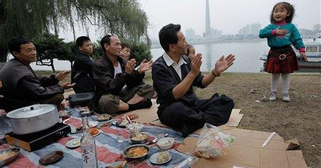 Picnics and paddleboats as Pyongyang celebrates