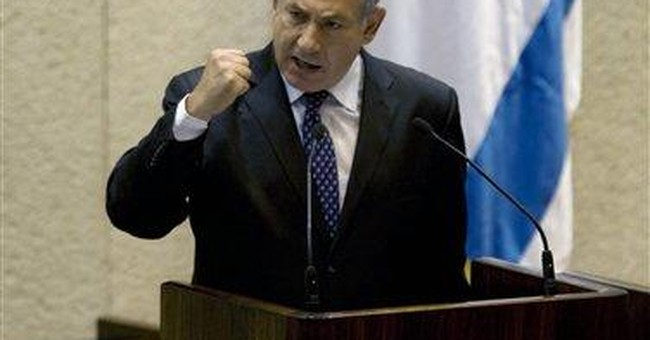 Israeli PM offers conditional settlements freeze