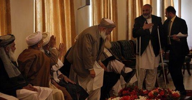 Afghan peace council members want gesture from US