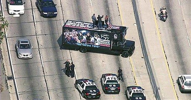 Band arrested after blocking LA freeway to perform