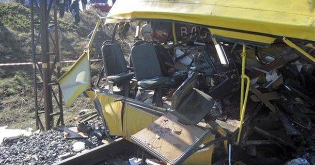 Ukraine: 43 killed in bus, train collision
