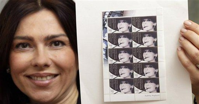 Rare Audrey Hepburn stamps up for auction