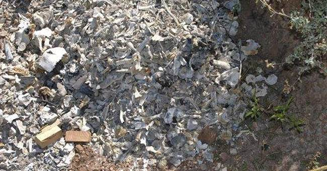 Countless human bones found in pits at AZ cemetery