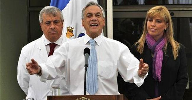 Chilean president brings mine rocks to London
