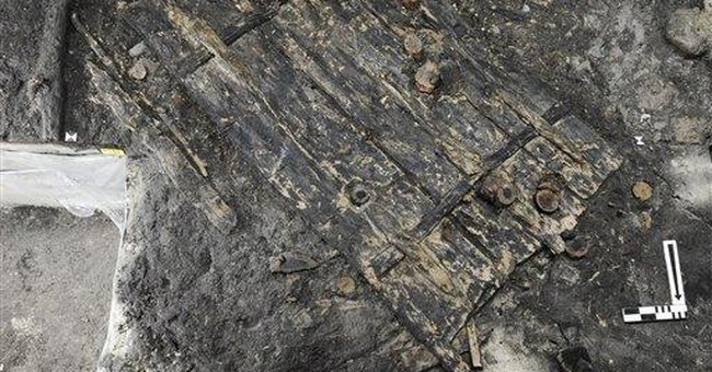 Swiss archaeologists find 5,000-year-old door