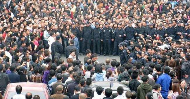 Hundreds stage anti-Japan protest in SW China