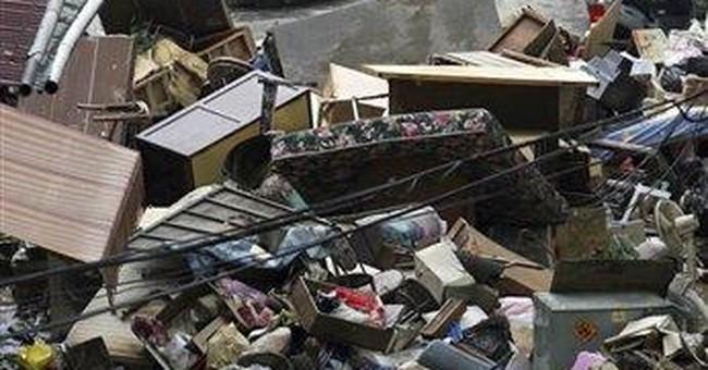 Rain drenches China as Megi weakens to depression