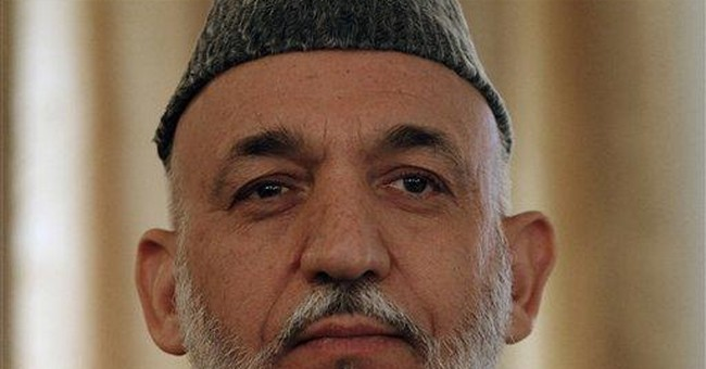 Karzai says his office gets cash from Iran, US